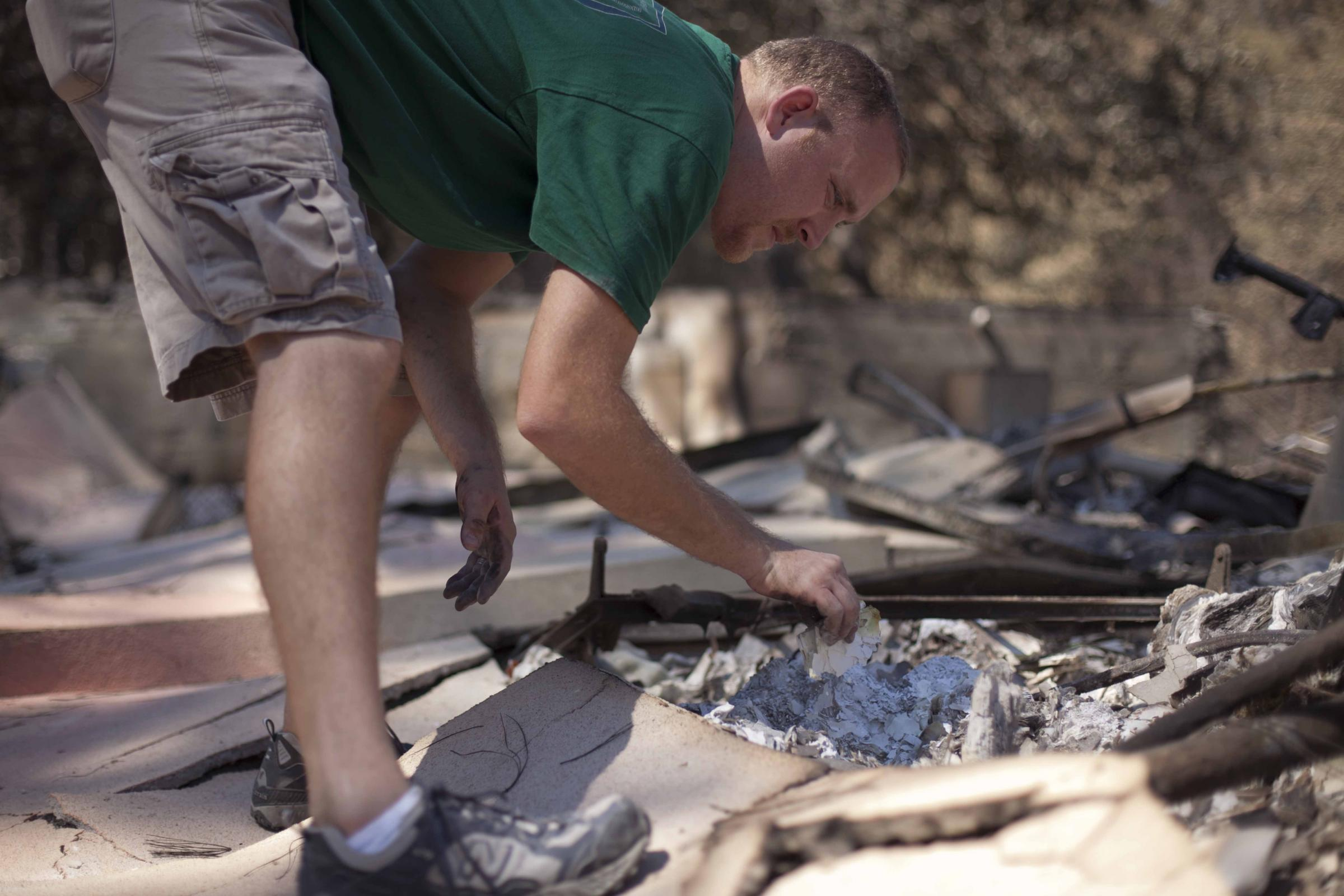 sifting through burned house